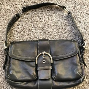 Black baguette bag with white stitching